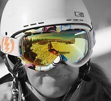 Sunshine through goggles - big white ski resort by Adam Smith