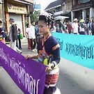 Thai Girl with Purple Banner in Floral Parade. by Mywildscapepics