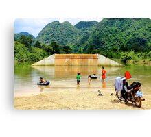 Family Sunday at the River - Thakhek, Laos. Canvas Print
