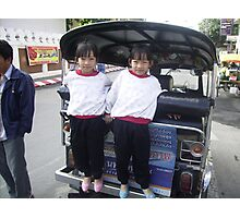 Twin Girls Standing on the Back of a Tuk Tuk. Photographic Print