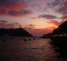 sun setting over San Sebastian by Lisa Howarth