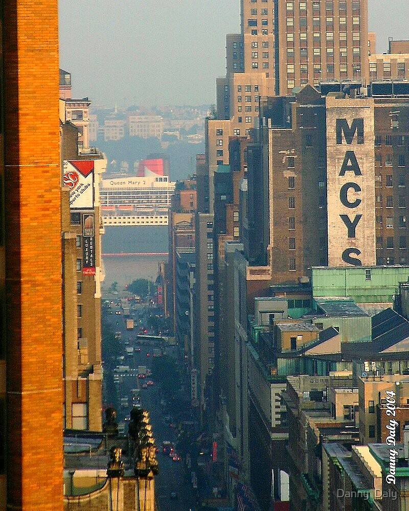 qm2 on the hudson river and 34th street NYC by Danny  Daly