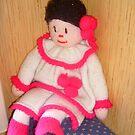 Doll with pink socks by Ana Belaj