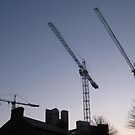 Cranes a work on a site Dublin by heartyart