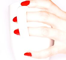 Female hand holding a white cup by Gabor Pozsgai
