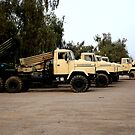 Kraz Trucks mounted with Russian Rocket Launchers  by Charles Buchanan