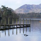 Jetty reflected in lake at Keswick by monkeyferret