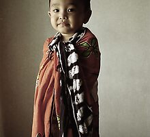a boy with a blanket by irenaeus herwindo