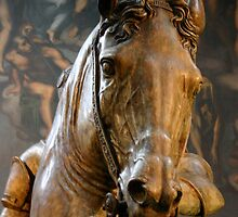 Horse statue in front of tapestry by churros