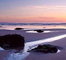 Peaceful beach at dusk by ianwoolcock