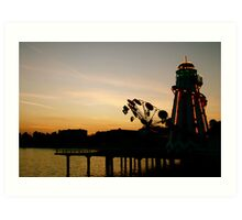 The sun sets on a seaside town Art Print