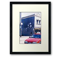 Black wall Red taxi Framed Print