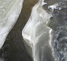 Frozen Flowing River by ashleyschneider