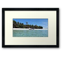 Pristine tropical shore with boat landed on the beach Framed Print