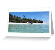 Pristine tropical shore with boat landed on the beach Greeting Card