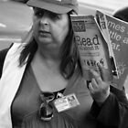 Big Issue Seller  by Andrew  Makowiecki