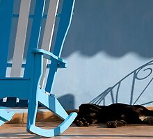 Sleeping dog & rocking chair, Cuba by buttonpresser