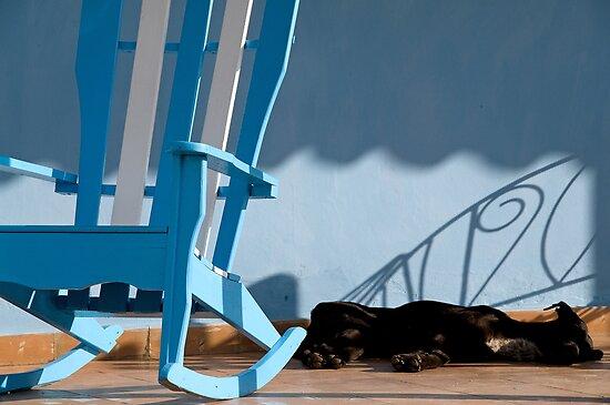Sleeping dog & rocking chair, Cuba by buttonpresser