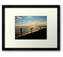 Sunset with People at the Beach Framed Print