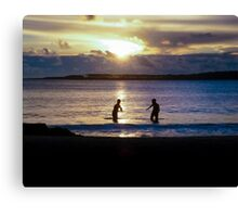 Childrens Playing in the Sea at Sunset Canvas Print