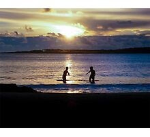 Childrens Playing in the Sea at Sunset Photographic Print
