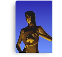 Woman in front of a blue background Canvas Print