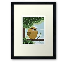 Owl in a branch Framed Print