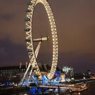 London Eye on the river at night by Dan Treasure