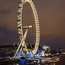 London Eye on the river at night by Dan Treasure