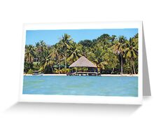 Tropical beach with thatched hut over the water Greeting Card
