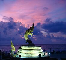 Dragon Statue in Thailand at Sunset by oliverjridgill
