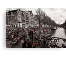 Bikes along a canal in Amsterdam Canvas Print