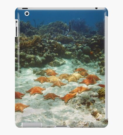 Many starfish underwater in a coral reef iPad Case/Skin