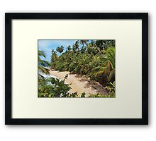 Wild tropical sandy beach with lush vegetation Framed Print