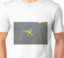 A green pond frog in black water. Unisex T-Shirt