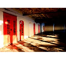Under the Pier Lies Another World of Red Doors and Light  Photographic Print