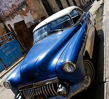 Classic car, run down area, Havana by buttonpresser