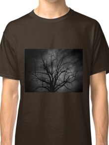 Evil lurks in twilight, dances in the dark..Black will not become a white...A rumble of thunder, I'm suddenly under your spell..The darkened deliver, I shake and I shiver down your soul Classic T-Shirt