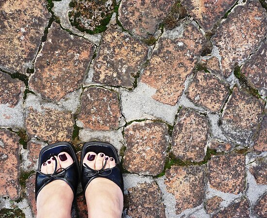 Black heels on the bricks by fourthangel