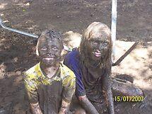 Kids in mud by Bernie Stronner