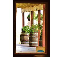 Decorative wine barrels through porch window Photographic Print