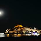 Moon rise over Peniscola. by Paul Pasco