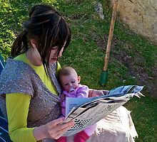 A mother and child reading the news by davridan