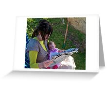 A mother and child reading the news Greeting Card