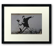 BOY LAUNCHES FLOWERS Framed Print