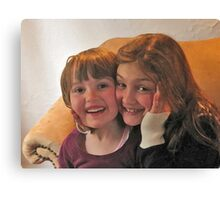 Little girls, big smiles Canvas Print