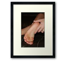 Touching her feet Framed Print