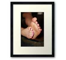 Rubbing creamed feet Framed Print
