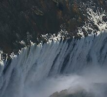Masses of Water- Victoria Falls Zimbabwe by Ouzopuppy