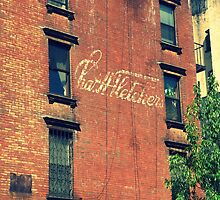 Old sign on side of apartment building by ShellyKay
